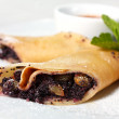 Pancakes with Poppy Seeds and Raisins close-up — Stock Photo #9704359