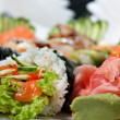 Sushi Assorted with Roll, Hand Roll, Sashimi, Ginger and Wasabi — Stock Photo