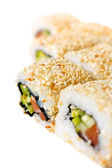Sushi Roll with salmon, sesame seeds, avocado and cucumber — Stock Photo