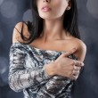 Sensual brunette with fashion silver dress in sensal position — Stock Photo