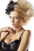 Blond hairstyle sexy girl with bra underwear wuth hand near the — Stock Photo