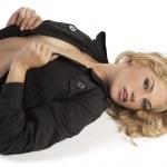 Sensual blonde girl with dark coat — Stock Photo