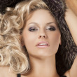 Stock Photo: Alluring girl with blond curly hair