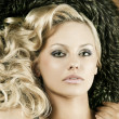 Stock Photo: Alluring sensual girl with blond curly hair