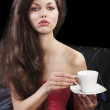Sophisticated lady drinkig tea, she looks in to the lens and tak — Stock Photo