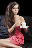 Sophisticated lady drinkig tea, she takes the cup with both hand — Stock Photo
