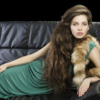 Young elegant girl in green with fur — Stock Photo