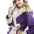 Blond haooy girl in bathrobe drinking champagne, she looks in o — Stock Photo #8162483