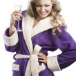 Blond haooy girl in bathrobe drinking champagne, she is on front — Stock Photo