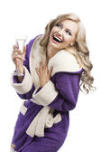 Blond haooy girl in bathrobe drinking champagne, she laughs and — Stock Photo