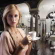 Blond sensual woman with a cup — 图库照片