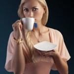 Blond sensual woman with tea set — Stock Photo