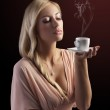 Blond sensual woman with a coffee set — Stock Photo #8215725