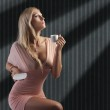Blond sensual lady with a cup coffee — Stock Photo #8215736
