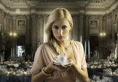 Blond sensual woman with a coffee cup — Stock Photo