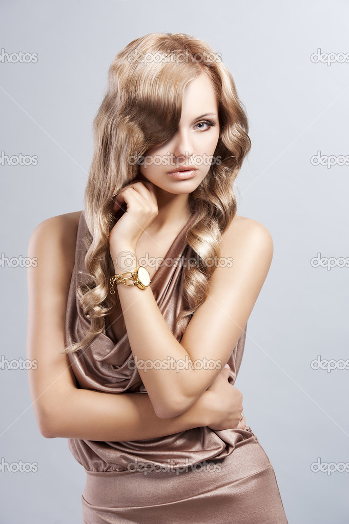 Very alluring and attractive young blond woman in elegant silk dress and with old fashion hair style — Stock Photo #8332490