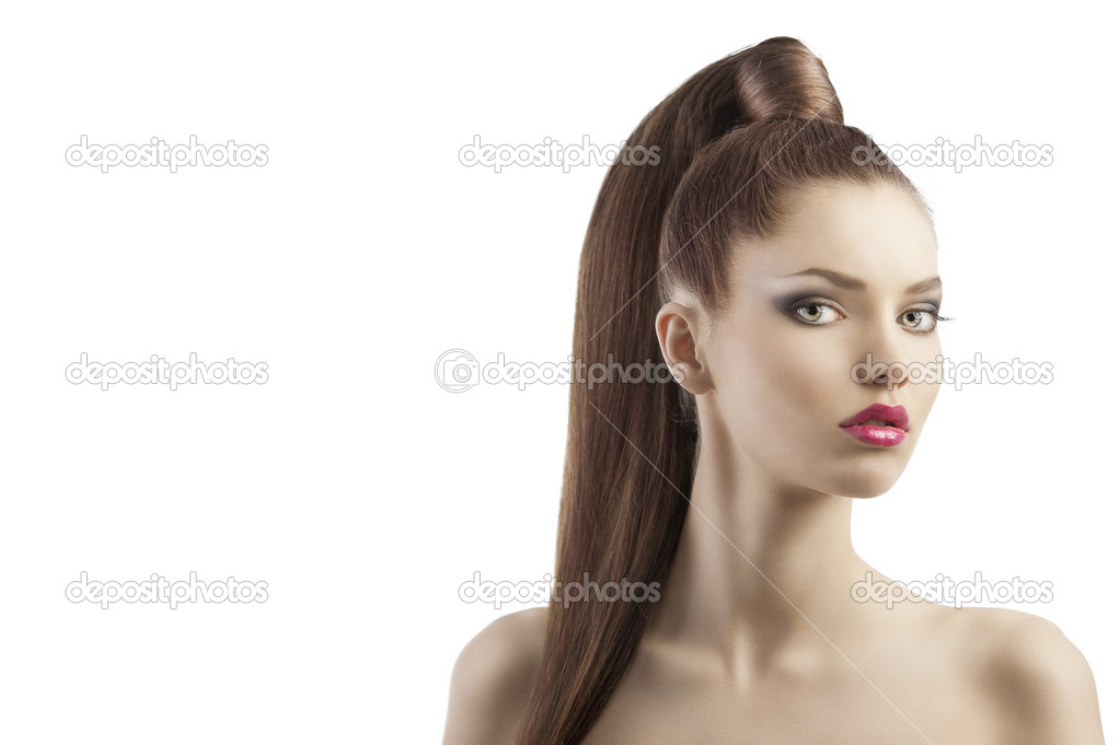 Very attractive young brunette with long hair and tail and creative hair style looking luxory and proud, she looks in to the lens and her mouth is slightly open  Stock Photo #8430806