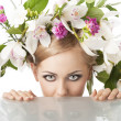 Pretty blond with flower crown on head, she is behind the table — Stock Photo