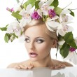 Pretty blond with flower crown on head, her face is turned of th — Stock Photo