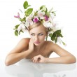 Pretty blond with flower crown on head, she looks at right — Stock Photo