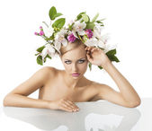 Pretty blond with flower crown on head, she is in front of the c — Stock Photo