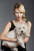 Old fashion blond girl,she has a dog in her arms — Stock Photo