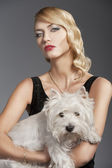 Old fashion blond girl, with dog — Stock Photo