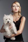 Old fashion blond girl, with dog she looks in to the lens — Stock Photo