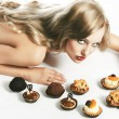 Royalty-Free Stock Photo: Blond sexy girl eating pastry, she looks in to the lens