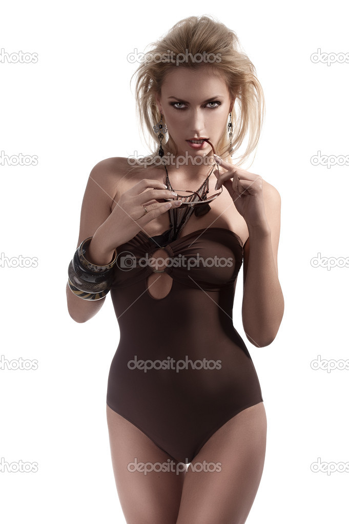 Blonde model posing sexy wearing a brown swimsuit and fashion accessories — Stock Photo #8625794