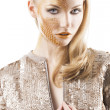 Stock Photo: Sequin glittering creative make up girl, she looks in to the