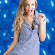 Fashion shot of summer girl in blue, her mouth is open - Stock Photo