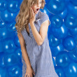 Fashion shot of summer girl in blue, she has an expression of su — Stock Photo