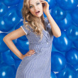 Fashion shot of summer girl in blue, she has the right hand on t — Stock Photo #8841882