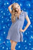 Fashion shot of summer girl in blue, she has a funny expression — Stock Photo
