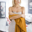 Blond girl in elegant dress, her arms are crossed — Stock Photo #8884202