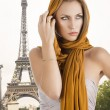 Blond girl in elegant dress, her right hand is near the face - Foto Stock
