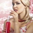 Fashion summer girl drinking, she drinks red drink - Foto Stock