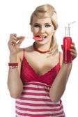 Fashion summer girl drinking, sh bites the lollipop — Stock Photo
