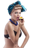 Blond young girl eating sweet — Stock Photo