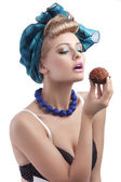 Blond young girl longing to eat a sweet — Stock Photo