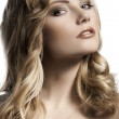 Blond young girl with stylish curled hair — Stock Photo