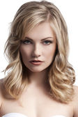 Blond young girl with stylish hair — Stock Photo