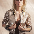 Fashion girl with sequins top - Stok fotoğraf