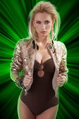 Fashion girl with shining sequins jacket — Stock Photo