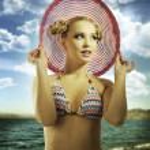 Blond girl wearing pink summer hat — Stock Photo