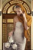 Elegant girl looking in her shopping bag — Stock Photo