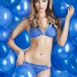 Swimsuit and balloons in blue, she has an actractive expression — Stock Photo #9177610
