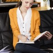 The girl reading a book with absorbed axpression - Stockfoto