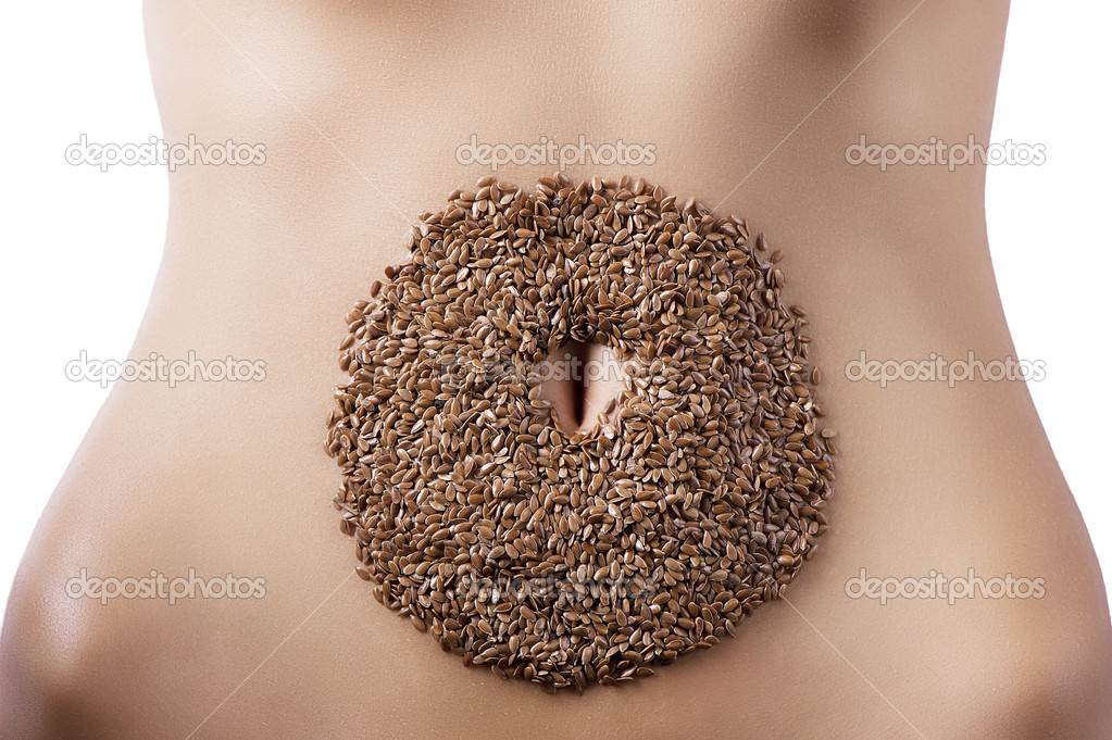 Round composition of barley placed around the navel  Stock Photo #9387944